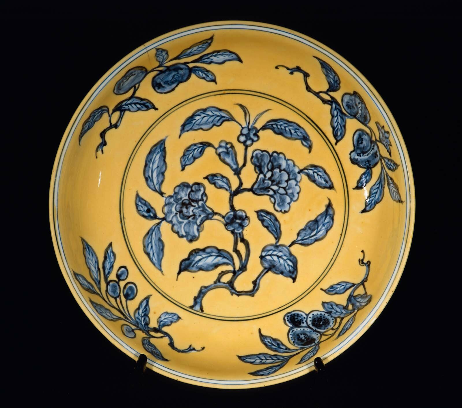 Plate with underglaze blue decoration of auspicious fruit branches over yellow ground, Chinese, Ming dynasty, Zhengde period (1505–21)