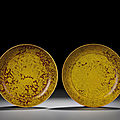 A rare pair of rare iron-red and yellow enamelled 'dragon' dishes, Jiajing six-character marks within double circles and of the period (1522-1566)