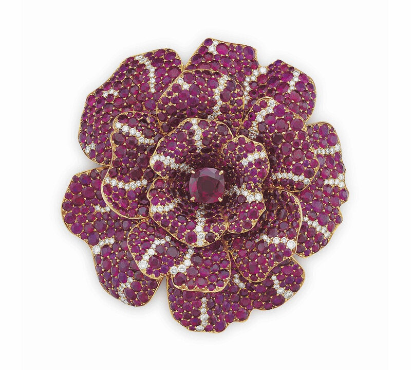 An elegant ruby and diamond 'Camellia' brooch, by Chanel
