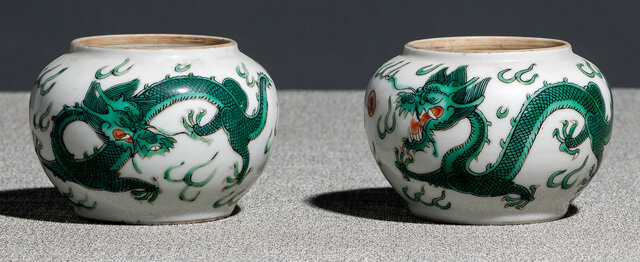 A pair of green dragon porcelain jars, iron-red Daoguang seal marks and period