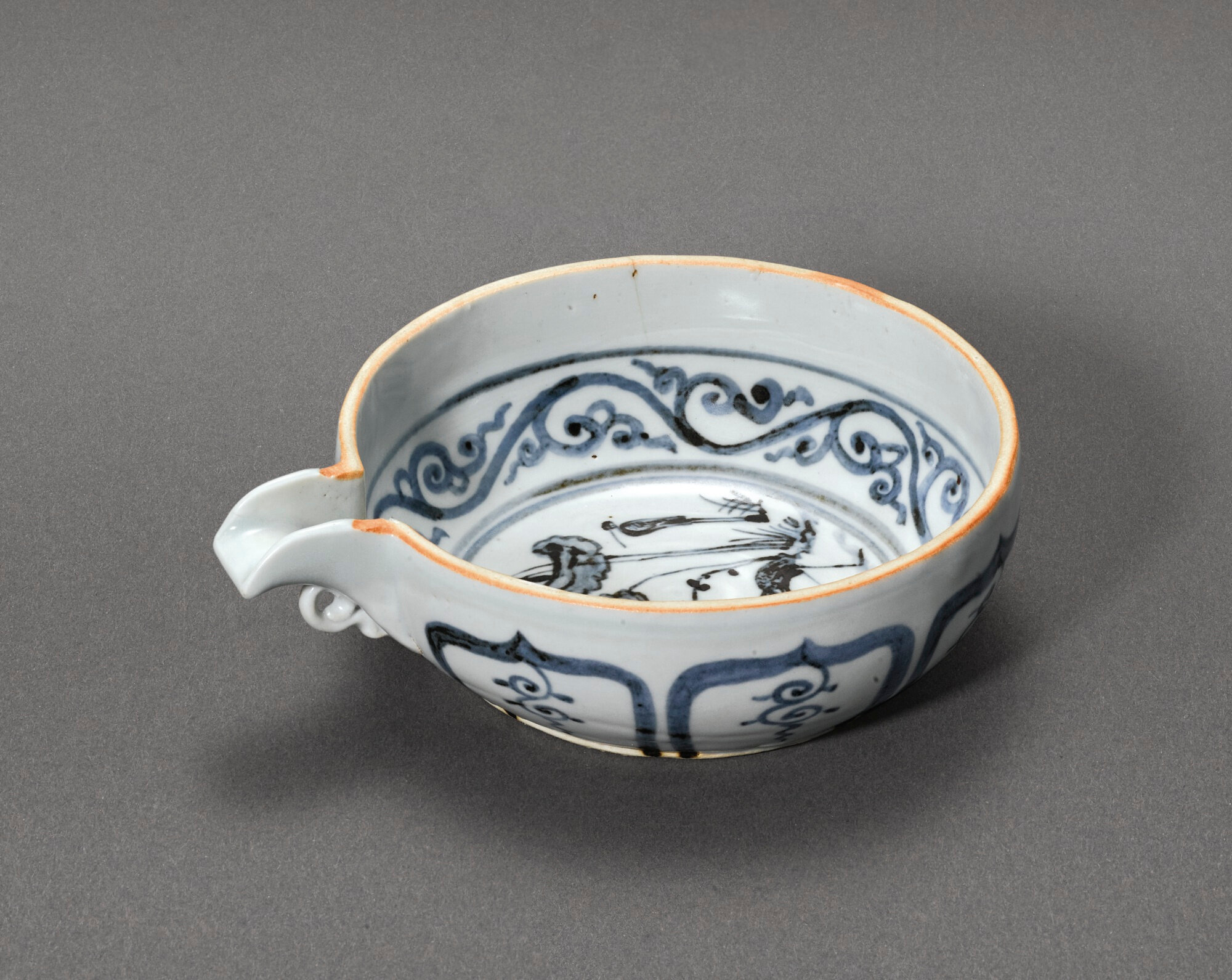 A blue and white 'Egrets and Lotus' pouring bowl, yi, Yuan dynasty (1279-1368)
