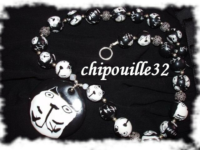 Collier avec cane de chat