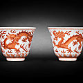 A pair of iron-red 'dragon' wine cups, guangxu six-character marks and of the period (1875-1908)
