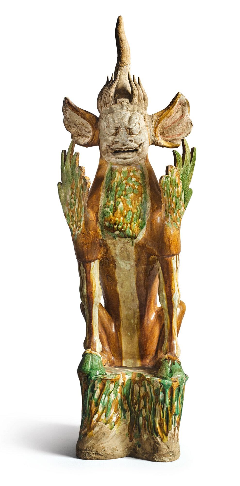 A sancai-glazed pottery figure of an earth spirit, Tang dynasty (618-907)