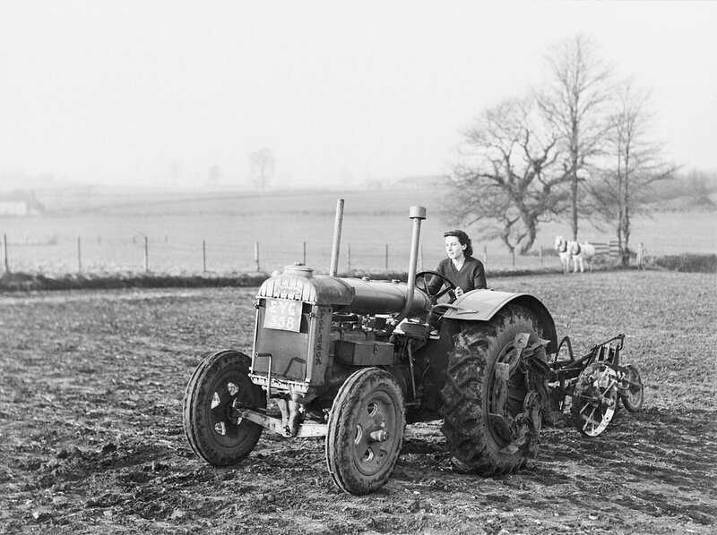 1280px-A_Land_Army_girl_using_a_Fordson_tractor_to_plough_a_field_at_the_Agricultural_College_at_Cannington_during_the_Second_World_War