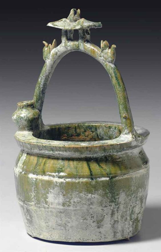 A green-glazed pottery model of a well head, Han dynasty (206 BC-AD 220)