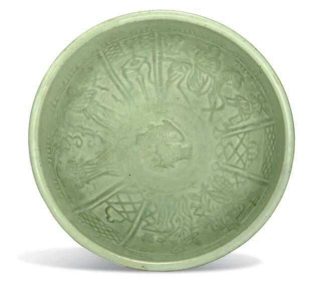 A Longquan celadon-glazed moulded 'figural' bowl, Ming dynasty, 15th century