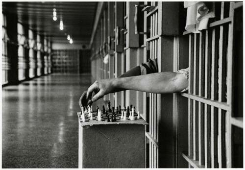 Inmates playing chess from prison