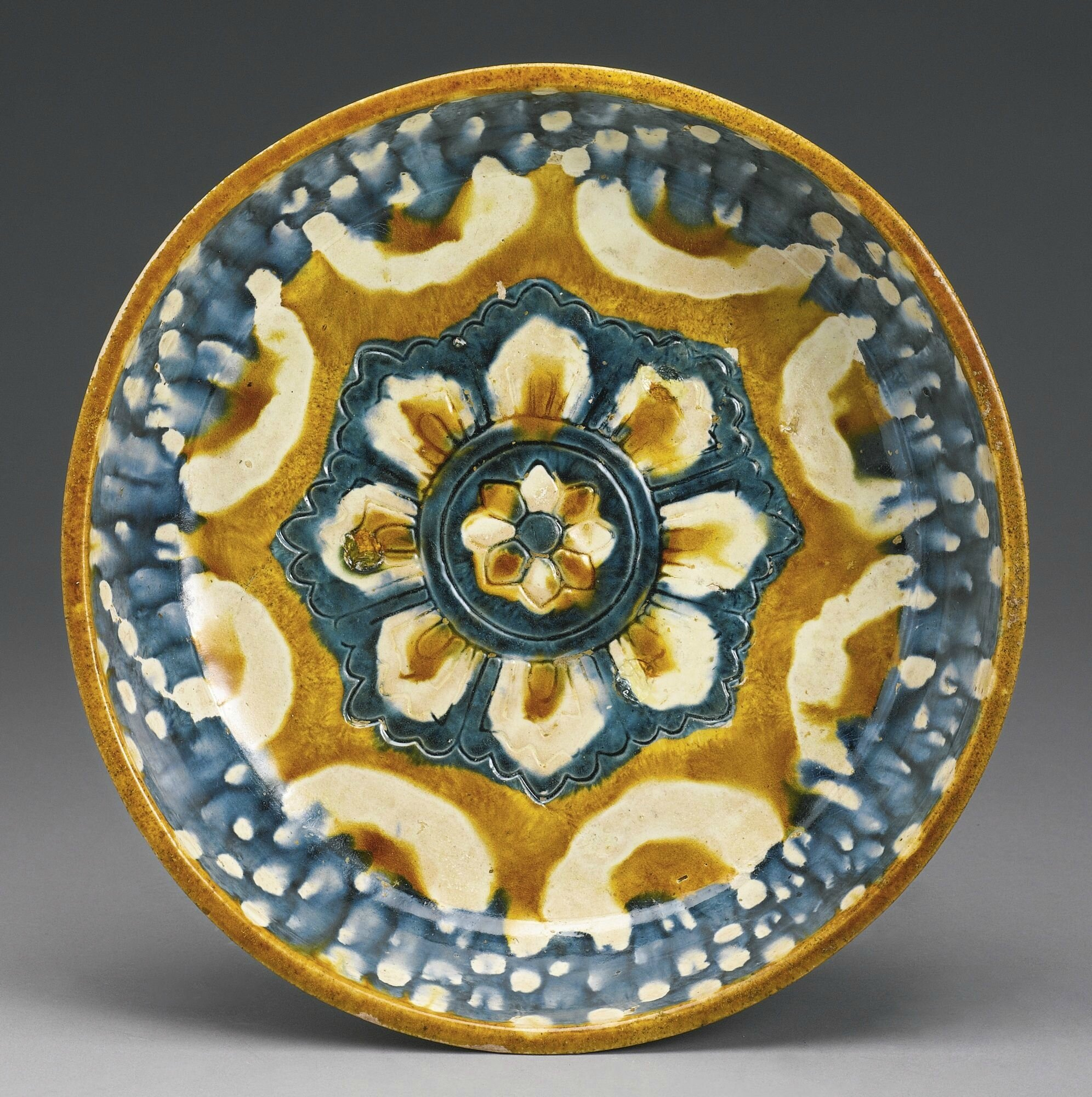 A rare large blue and sancai-glazed pottery basin, Tang dynasty