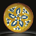 A rare amber, cream and blue-glazed shallow dish, Tang dynasty (618-907)