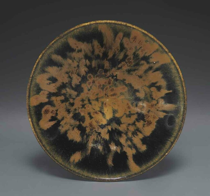 A black-glazed conical bowl with russet 'partridge feather mottles', Northern Song-Jin dynasty, 11th-12th century