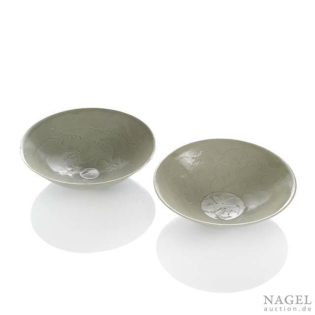 Two cream-glazed engraved bowls with flower motifs, China, Song dynasty