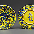 A rare pair of small yellow-ground blue and white lobed dishes, Jiajing six-character marks in underglaze blue and of the period (1522-1566)