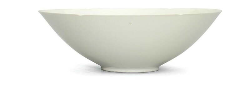 A very rare white-glazedanhua-decorated foliate-rimmed bowl, Yongle incised four-character mark within a circle and of of the period ( 1403-1424)