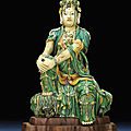A rare ming sancai glazed stoneware figure of guanyin, ming dynasty, 16th century