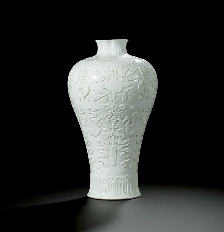 A rare white-glazed relief-carved vase, meiping, Qing dynasty, Qianlong period (1736-1795)