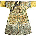 A rare yellow embroidered twelve-symbol semi-formal 'dragon' robe, qing dynasty, 19th century