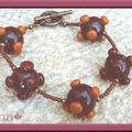 Bracelet marron à pics orange AC (N)