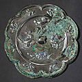 A silvery grey bronze eight-lobed mirror, Tang dynasty (618-907)