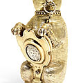 A german silver-gilt cup and cover in the form of a bear, maker's mark only mv conjoined, the shield melchior bair, augsburg, ci