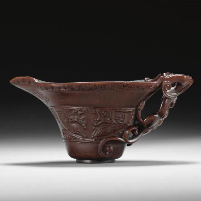 An archaistic carved rhinoceros horn libation cup, Qing dynasty, 17th/18th century