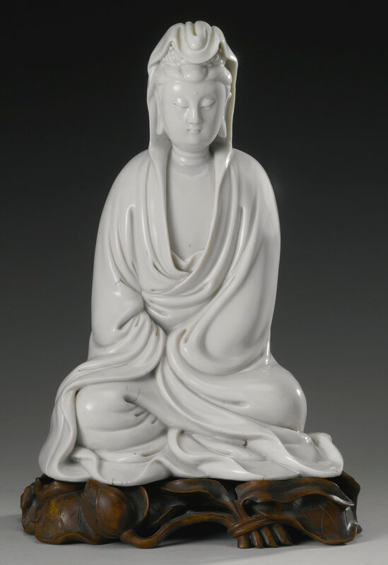 A 'Dehua' figure of seated Guanyin, Qing dynasty, 17th century4