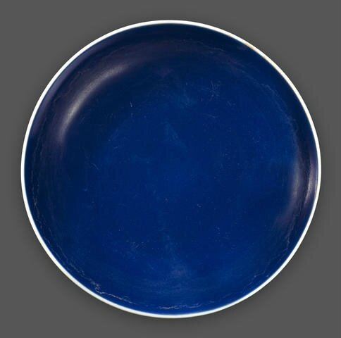 A blue glazed deep dish, Qianlong six-character mark and of the period. Photo Bonhams