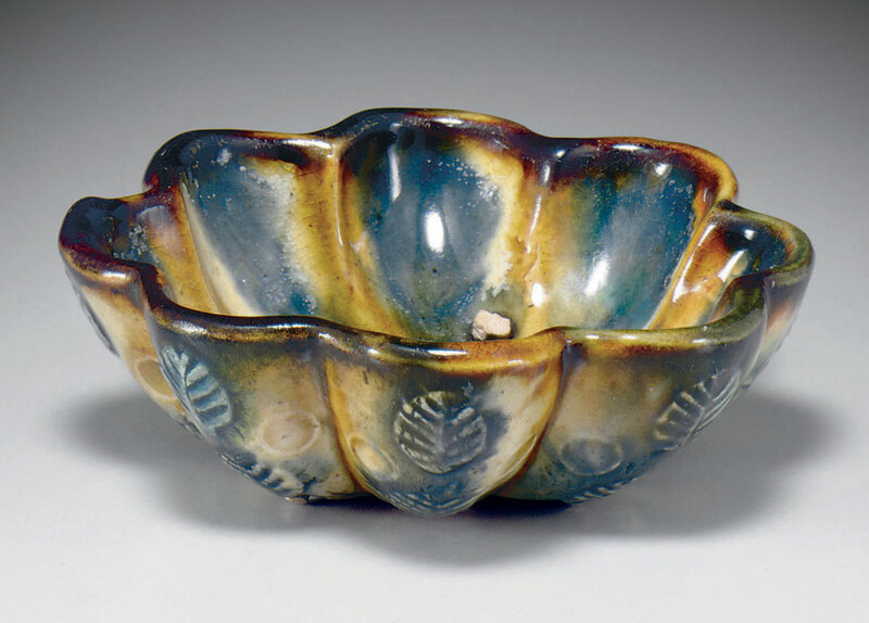 A small blue, amber and clear-glazed octalobed bowl, Tang dynasty (618-907)