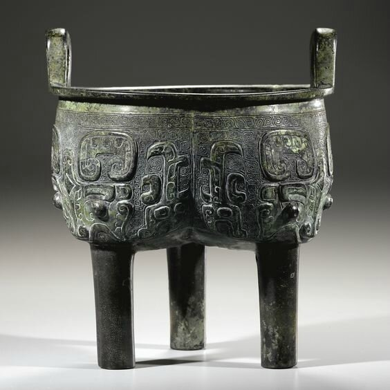 A fine archaic bronze ritual food vessel, liding, Late Shang dynasty (c