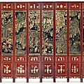A massive chinese black, gilt and red lacquered twelve-panel screen. the black lacquer panels qianlong with date inscription