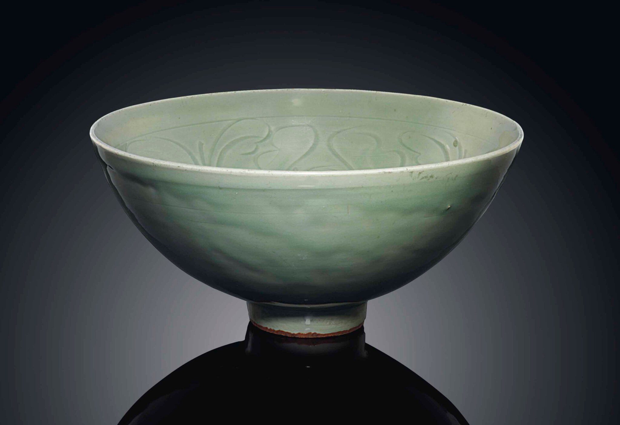 A Longquan celadon carved bowl, Ming dynasty, 15th century