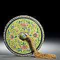 An imperial canton enamel yellow-ground mirror, late qianlong-jiaqing period