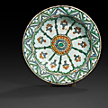 An ottoman iznik pottery dish, tabak, decorated with a central rosette, turkey, 17th century