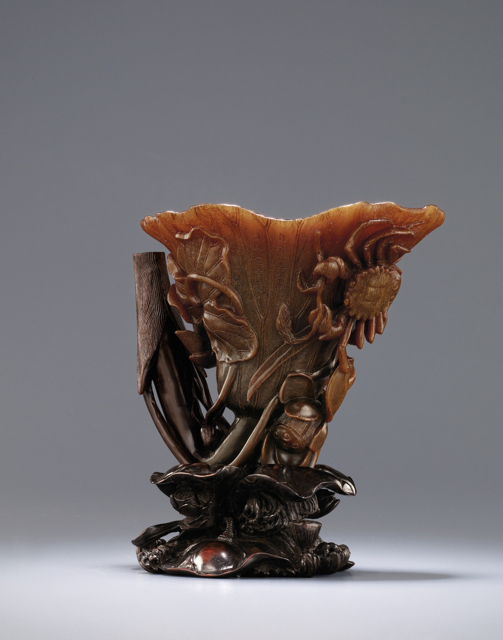 A rare and supberly carved lotus-leaf shaped rhinoceros horn waterdropper, Kangxi period (1662-1722)