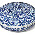 A circular blue and white 'peony' box and cover, kangxi mark and period (1662-1722)