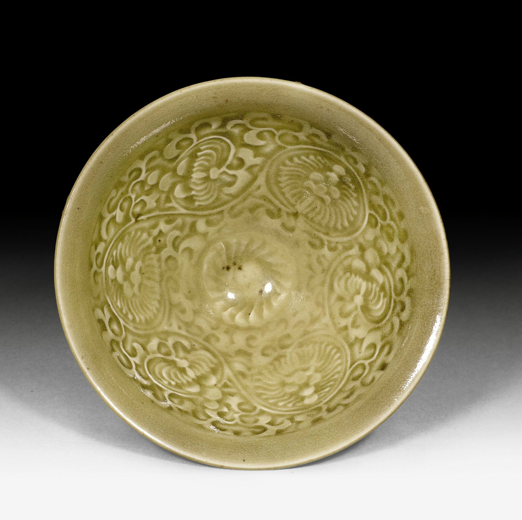 A small celadon glazed Yaozhou bowl with floral spray inside, China, Song dynasty