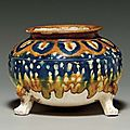 A_blue__amber_and_straw_glazed_pottery_tripod_censer__Tang_dynasty__618_907__