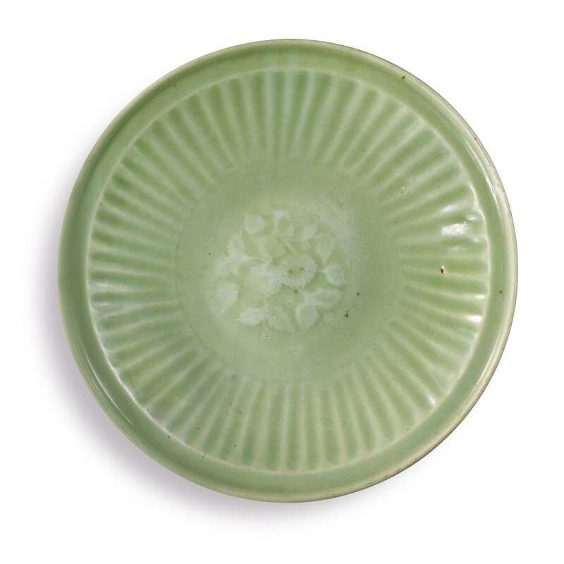 A 'Longquan' celadon-glazed molded 'floral' dish, early Ming dynasty (1368-1644)