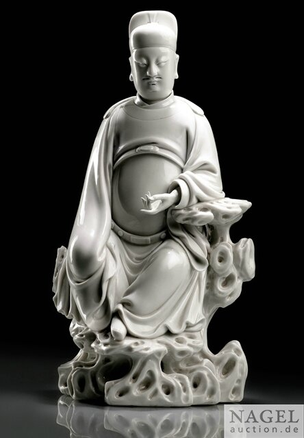 A finely modeled Dehua figure of Wen Chang, impressed gourd-shaped potter's mark He Chaozong, 17th century