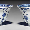 A pair of blue and white 'dragon' and 'phoenix' bowls, kangxi period (1662-1722)