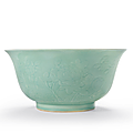A rare large celadon-glazed relief-decorated bowl, qianlong six-character seal mark in underglaze blue and of the period (1736-1