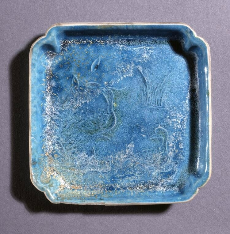 Square porcelain dish with raised slip decoration and monochrome turquoise glaze, Ming dynasty, Jiajing period (1522-1566)
