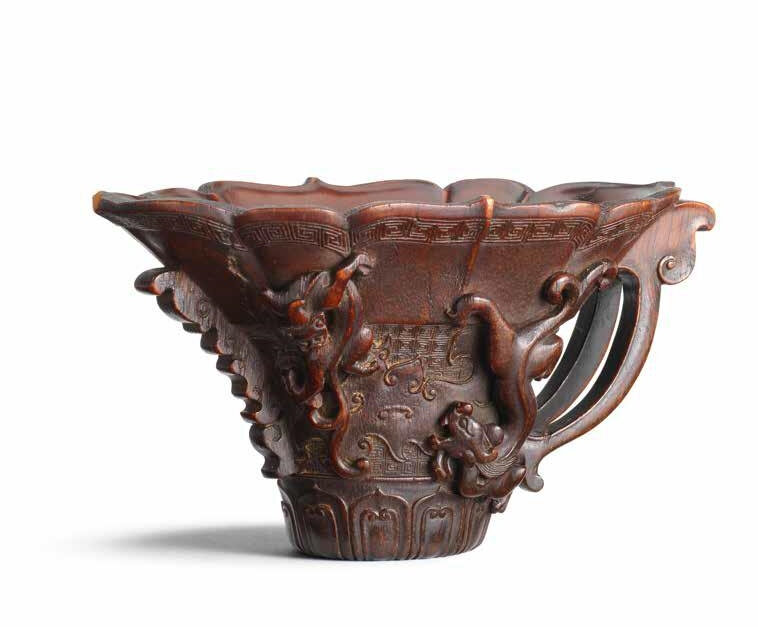 An exquisitely carved rhinoceros horn archaistic 'chilong' libation cup, 17th-18th century