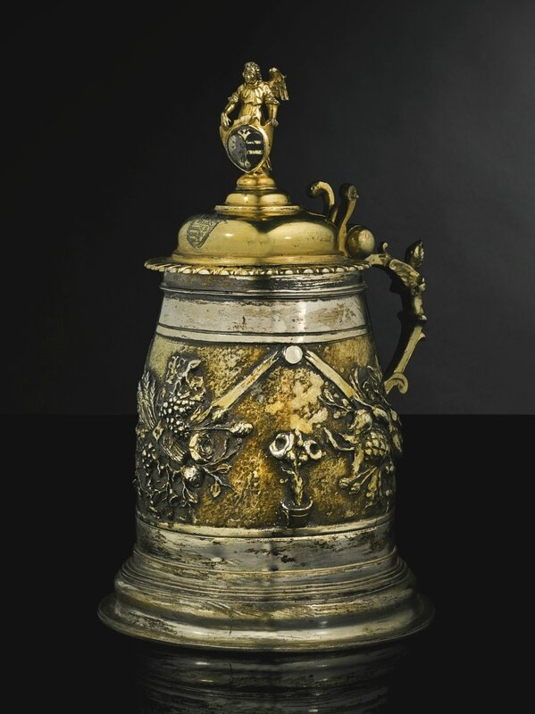 A German parcel-gilt silver tankard cover and foot, Hans Fens, Augsburg, probably 1610-12 and later