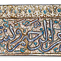 A kashan moulded pottery lustre tile, persia, 13th-14th century