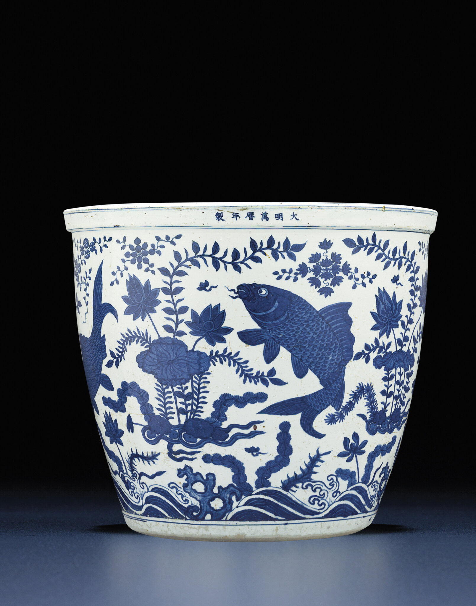 An extremely rare Ming large blue and white 'carp' fishbowl