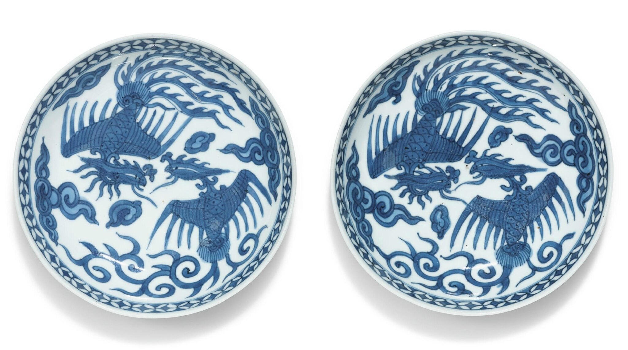 A pair of blue and white 'phoenix' dishes, Wanli marks and period (1573-1619)