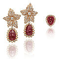 A pair of ruby and diamond ear pendants, by van cleef & arpels and a ring