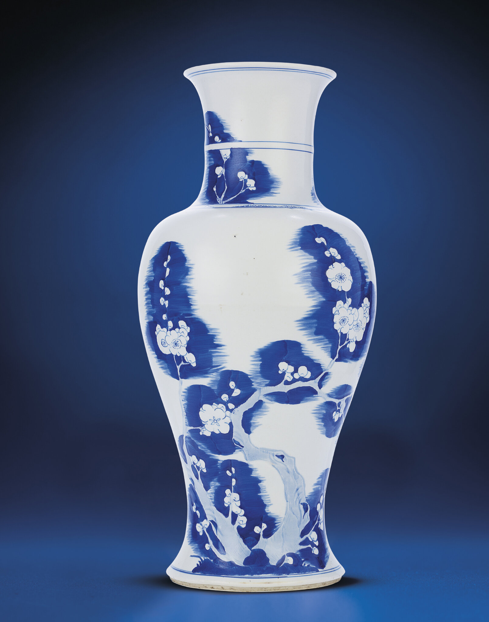 A very rare carved blue and white 'Prunus' baluster vase, Kangxi period (1662-1722)