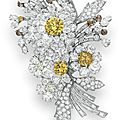 A colored diamond and diamond flower brooch, by bvlgari